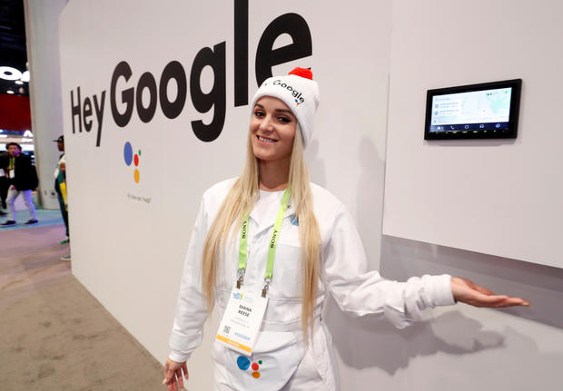 Demonstrator Diana Reese poses by an auto infotainment system equipped with Google Assistant in the JVC-Kenwood booth during the 2019 CES in Las Vegas