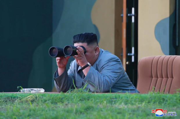 North Korean leader Kim Jong Un watches the test-fire of two short-range ballistic missiles
