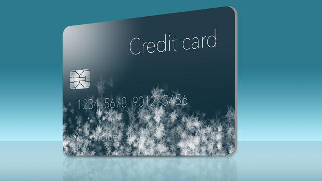 Frost covered credit cards illustrate putting a credit freeze on a credit report.