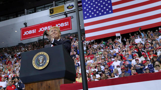 U.S. President Donald Trump speaks supporters during a campaign rally in Cincinnati