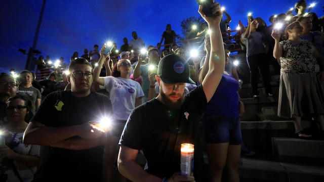 Francisco Castaneda joins mourners taking part in a vigil at El Paso High School after a mass shooting at a Walmart store in El Paso, Texas, Aug. 3, 2019.