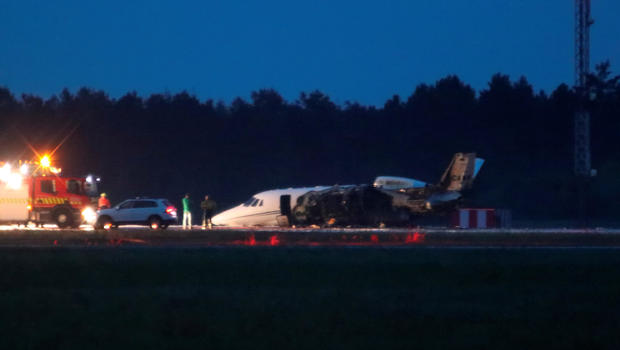 A private Cessna 560XL aircraft is seen after crashing while landing at Aarhus Airport in Tirstrup