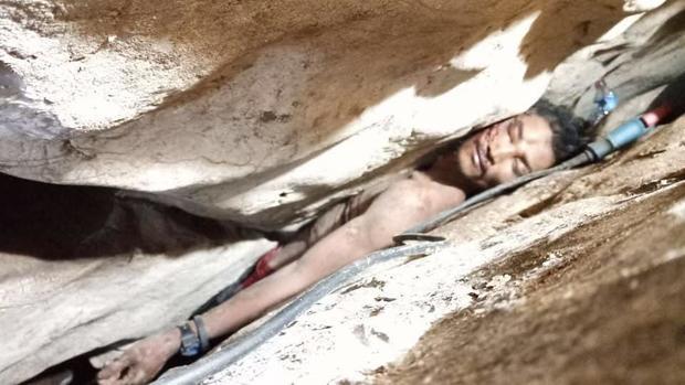 cambodia-cave-wedged-between-rocks.jpg