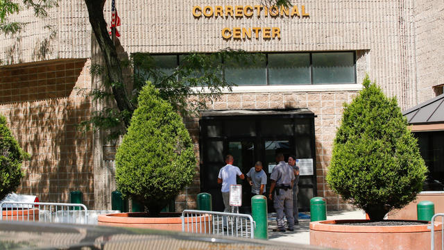 Security personnel and people are seen at the entrance of the Metropolitan Correctional Center jail where financier Jeffrey Epstein was held in the Manhattan borough of New York City Aug. 12, 2019.