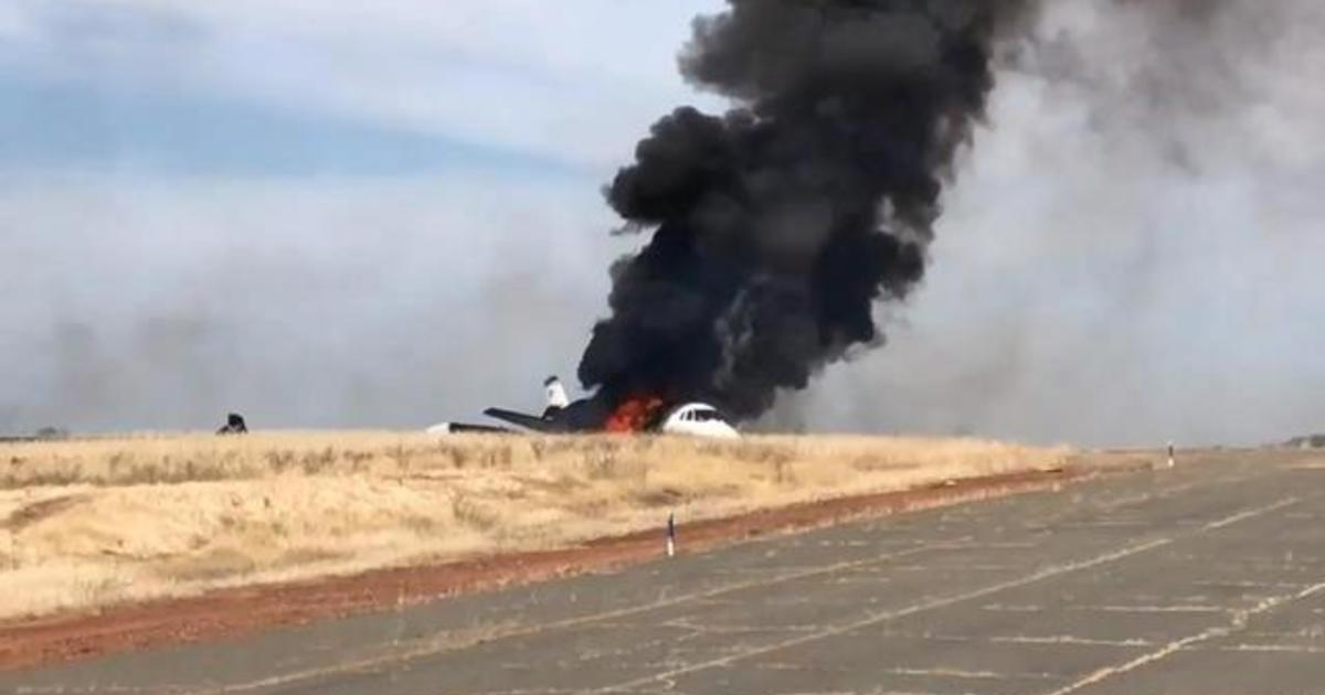 All 10 passengers survive after plane skids off runway, bursts into flames