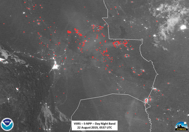 Active fires, represented by red dots, are pictured from space over Bolivia