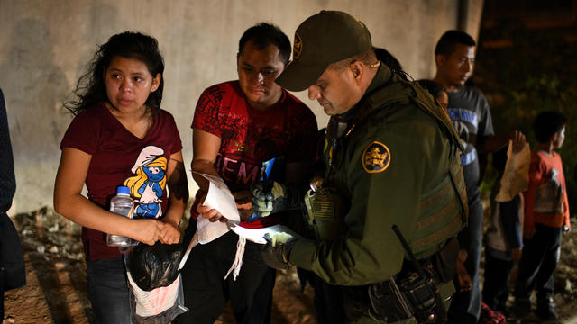 Migrant families turn themselves in to U.S. Border Patrol to seek asylum following an illegal crossing of the Rio Grande in Hidalgo