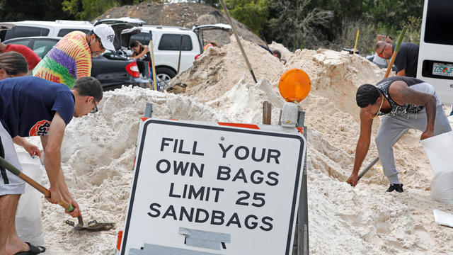 Local residents fill sandbags ahead of the arrival of Hurricane Dorian in Kissimmee