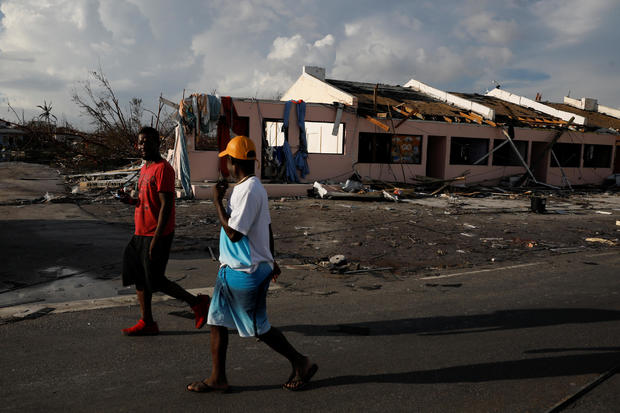 Men walk past a destroyed shopping mall after hurricane Dorian hit the Abaco Islands in Marsh Harbour