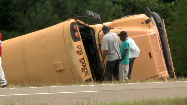 Crews work the scene of a deadly school bus crash in Benton County, Mississippi, on September, 10, 2019.