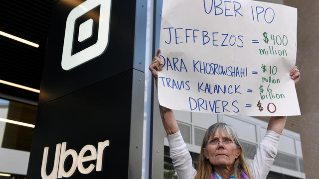 Uber drivers strike against the company's recent 25 percent wage cut outside Uber's head office in San Francisco
