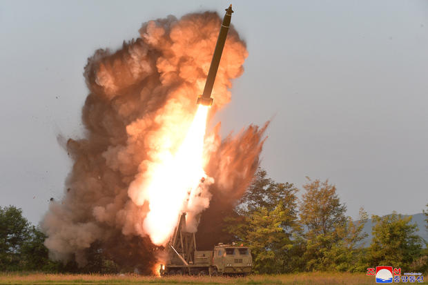 A view shows the testing of a super-large multiple rocket launcher in North Korea