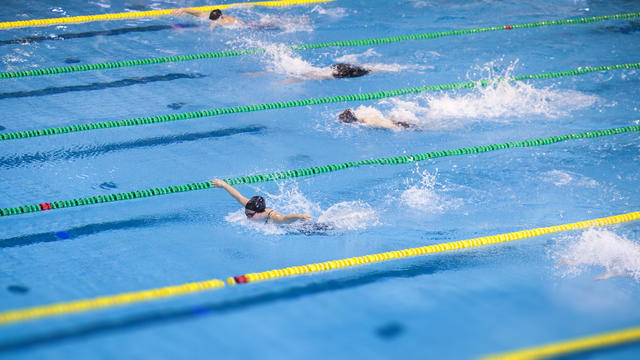 Butterfly stroke swimming competition for women
