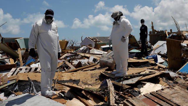 Police officers search for the dead in the destroyed Mudd neighborhood after Hurricane Dorian hit the Abaco Islands in Marsh Harbour
