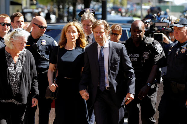 Actress Felicity Huffman and husband William H. Macy arrive at the federal courthouse in Boston