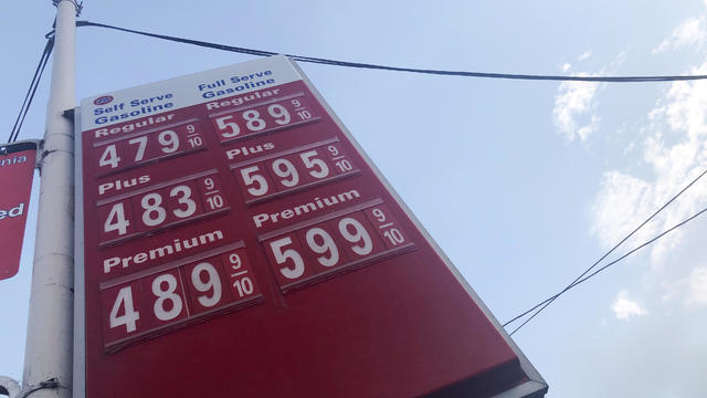 FILE PHOTO: A sign displaying gas prices is seen in Los Angeles