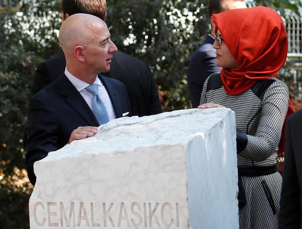 Hatice Cengiz, fiancee of murdered Saudi journalist Jamal Khashoggi, and Jeff Bezos, founder of Amazon and Blue Origin, talk as they attend a ceremony marking the first anniversary of Khashoggi's killing at the Saudi Consulate in Istanbul, Turkey, October 2, 2019.