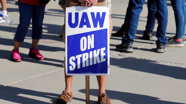 "A ""UAW On Strike"" sign is seen during a rally outside the shuttered GM Lordstown Assembly plant during the United Auto Workers national strike in Lordstown, Ohio"
