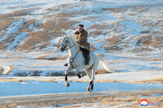 North Korean leader Kim Jong Un rides a horse during snowfall in Mount Paektu