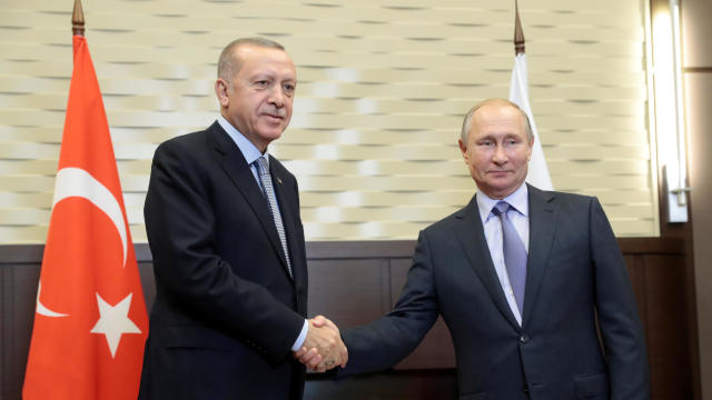 Russian President Vladimir Putin shakes hands with Turkish President Recep Tayyip Erdogan during their meeting in the Black sea resort of Sochi
