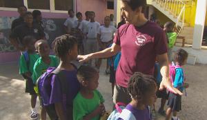 mitch-albom-with-children-at-have-faith-haiti-mission-promo.jpg