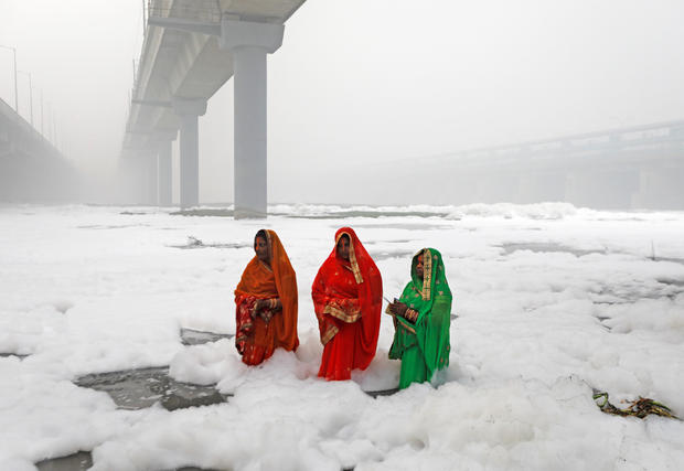 Hindu women worship the sun god in the polluted waters of the Yamuna River during the Hindu religious festival Chat Puja in New Delhi. Chatth Puja in New Delhi, India, November 3, 2019. </span></p> <p>                  <span class=