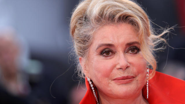 """Catherine Deneuve walks the red carpet ahead of the opening ceremony and a screening of """"La Vérité"""" (The Truth) during the 76th Venice Film Festival at Sala Grande on August 28, 2019, in Venice, Italy."""