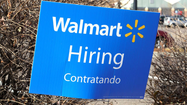 A sign seeking workers is seen at a Walmart store in Westminster
