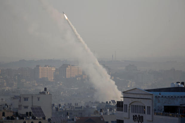 Rocket is fired from Gaza towards Israel, in Gaza