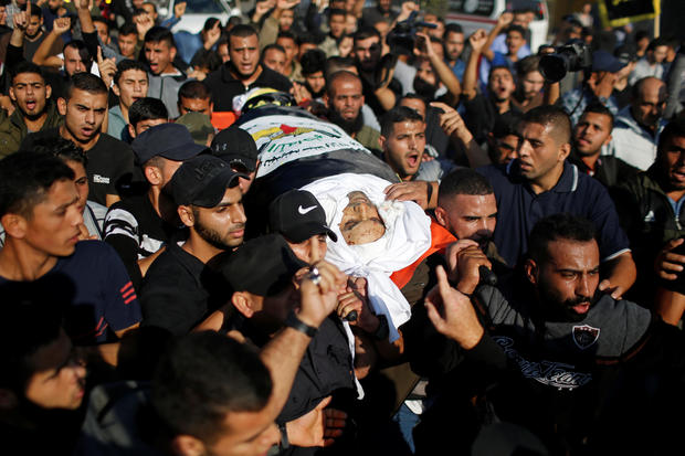 Mourners carry the body of Palestinian Islamic Jihad field commander Baha Abu Al-Atta during his funeral in Gaza City