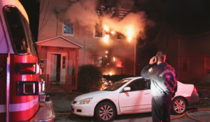 Firefighter killed saving others in Massachusetts house fire