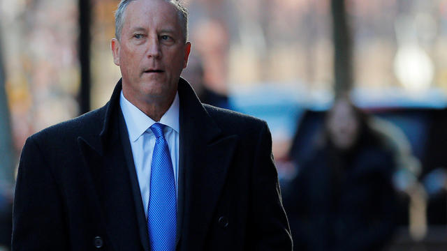 Martin Fox arrives at the federal courthouse before entering a plea in Boston