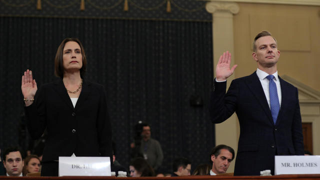 Fiona Hill takes the oath with David Holmes before testifying in front of the House Intelligence Committee hearing as part of Trump impeachment inquiry on Capitol Hill in Washington