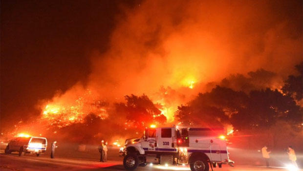 """Cave Fire"" explodes in California mountains, threatens homes"