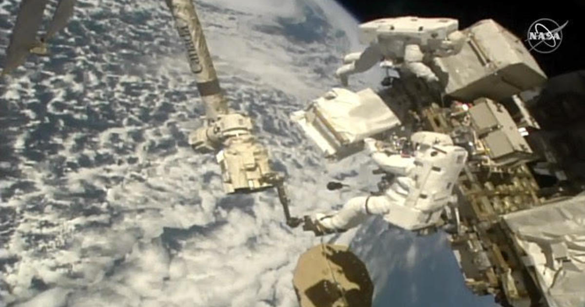 Spacewalk: Astronauts replace coolant pumps on $2 billion cosmic ray detector