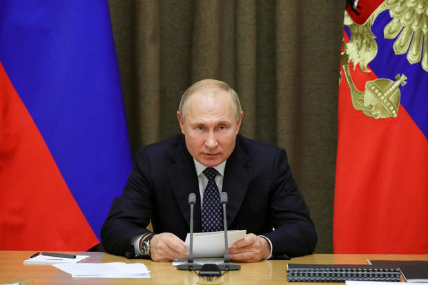 Russian President Vladimir Putin chairs a meeting with top officials of the Russian Defence Ministry in Sochi