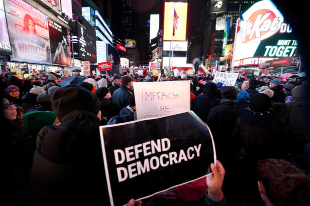 Demonstrators gather to demand the impeachment and removal of U.S. President Donald Trump during a rally at Times Square in New York City