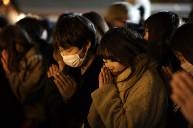 People offer their New Year's prayers at the Meiji Jingu Shinto shrine on New Year's Day 2020 in Tokyo.