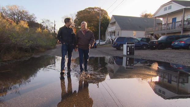 john-bluming-and-brook-silva-braga-flooding-on-his-street-threatens-his-house.jpg