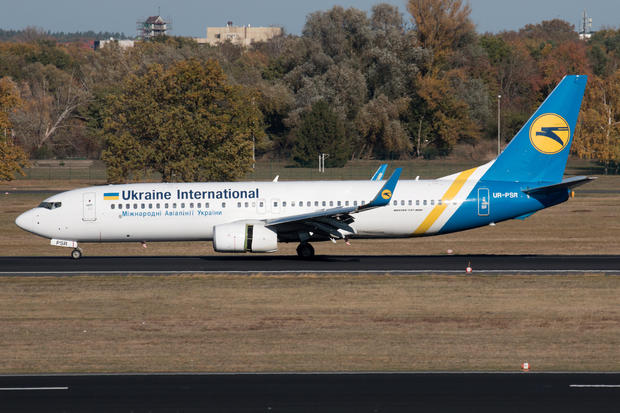 Ukraine International Airlines Boeing 737-800 with the registration UR-PSR, taxis at Berlin Tegel airport