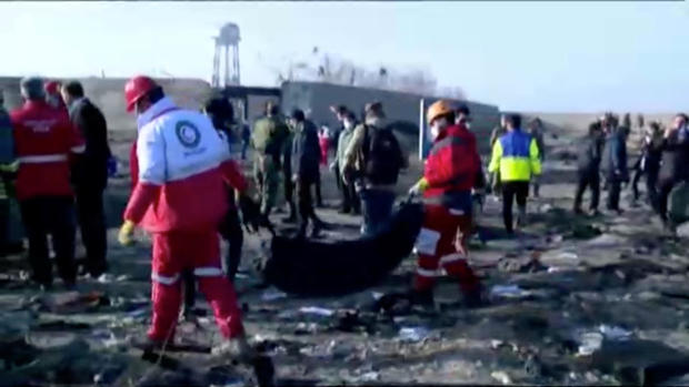 Emergency workers work near the wreckage of Ukraine International Airlines flight PS752, a Boeing 737-800 plane that crashed after taking off from Tehran's Imam Khomeini airport