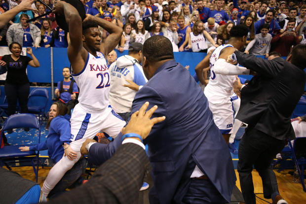 Silvio De Sousa, No. 22 of the Kansas Jayhawks, picks up a chair during a brawl as the game against the Kansas State Wildcats ends at Allen Fieldhouse on January 21, 2020, in Lawrence, Kansas.