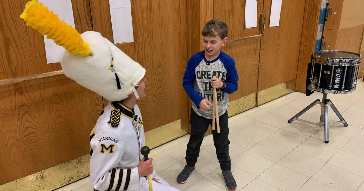 The Michigan Marching Band finds a future recruit in a 9-year-old fan