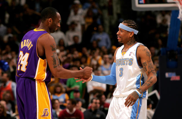 Kobe Bryant, No. 24 of the Los Angeles Lakers, and Allen Iverson, No. 3 of the Denver Nuggets, greet each other before tip-off at the Pepsi Center on March 15, 2007, in Denver, Colorado.
