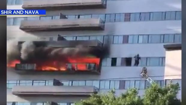 high-rise-fire-man-outside-window.jpg