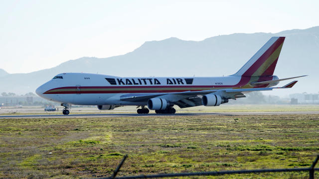 A chartered jet carrying U.S. consulate employees from China arrives at March Air Reserve Base in Riverside County