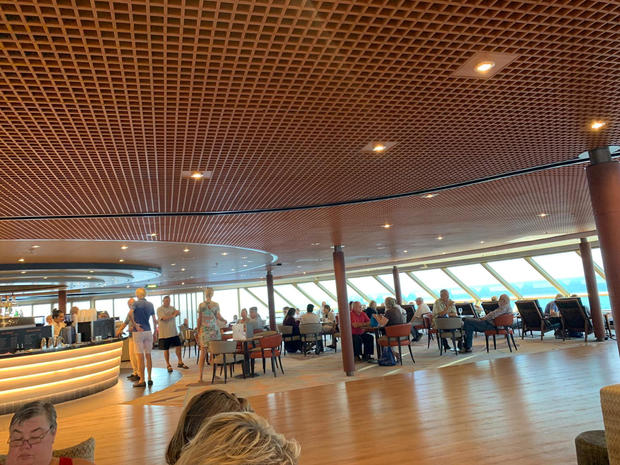 Passengers relax on board the Holland America-operated Westerdam cruise ship
