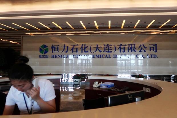 FILE PHOTO: An employee speaks on the phone at the reception of Hengli Petrochemical's new refining, petrochemical complex, at Changxing island in Dalian
