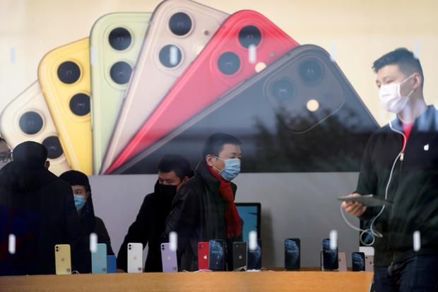 People wearing protective masks are seen in an Apple Store in Shanghai, China, January 29, 2020.
