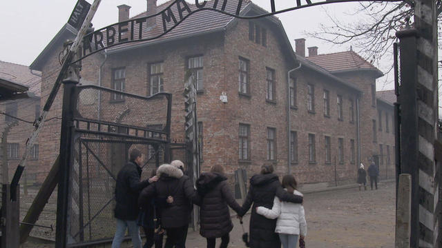 michael-bornstein-and-family-pass-through-gate-at-auschwitz-promo.jpg